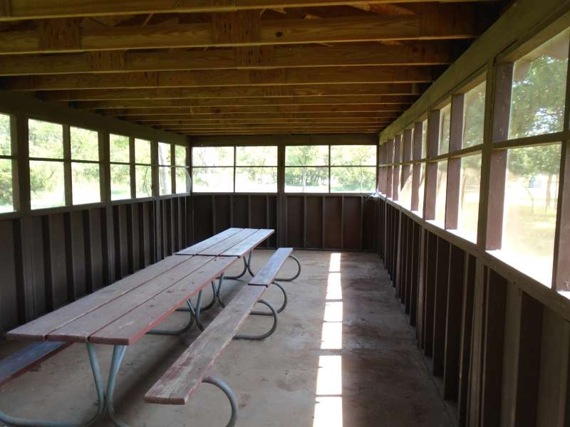 3-picnic tables are inside the screened pavilion.