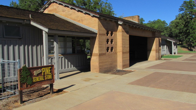 Back side of building, with recreation hall in the back and park store in the foreground.