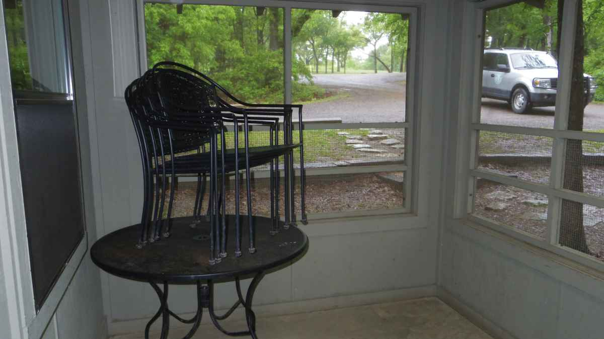 Inside the Screened front porch of the cabin.
