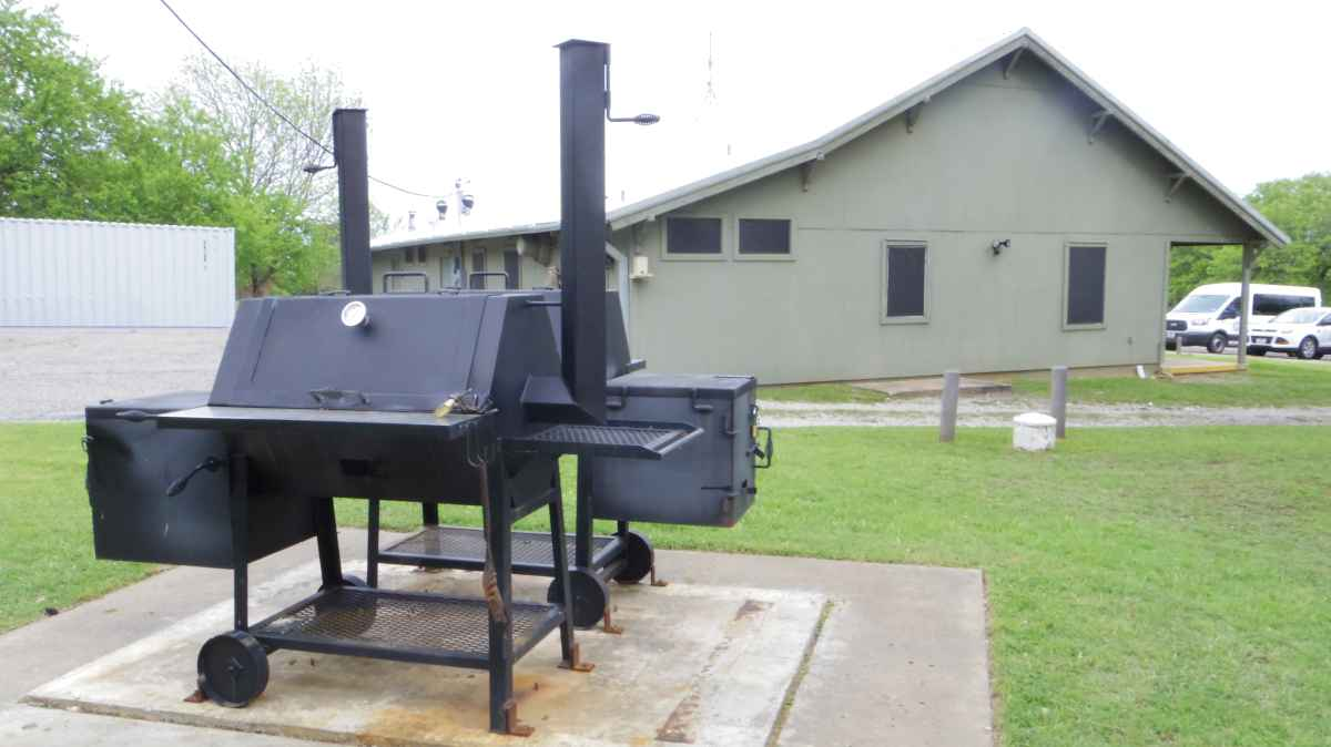 Outside the side of the Rec. Hall are grills/smokers.