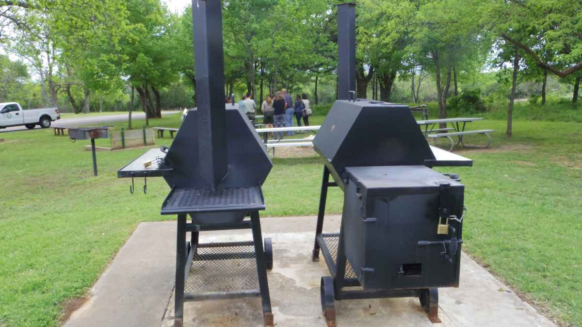 next to the Rec. Hall is a gathering area with 3 grills, picnic tables, a large fire pit, and horseshoe pits.