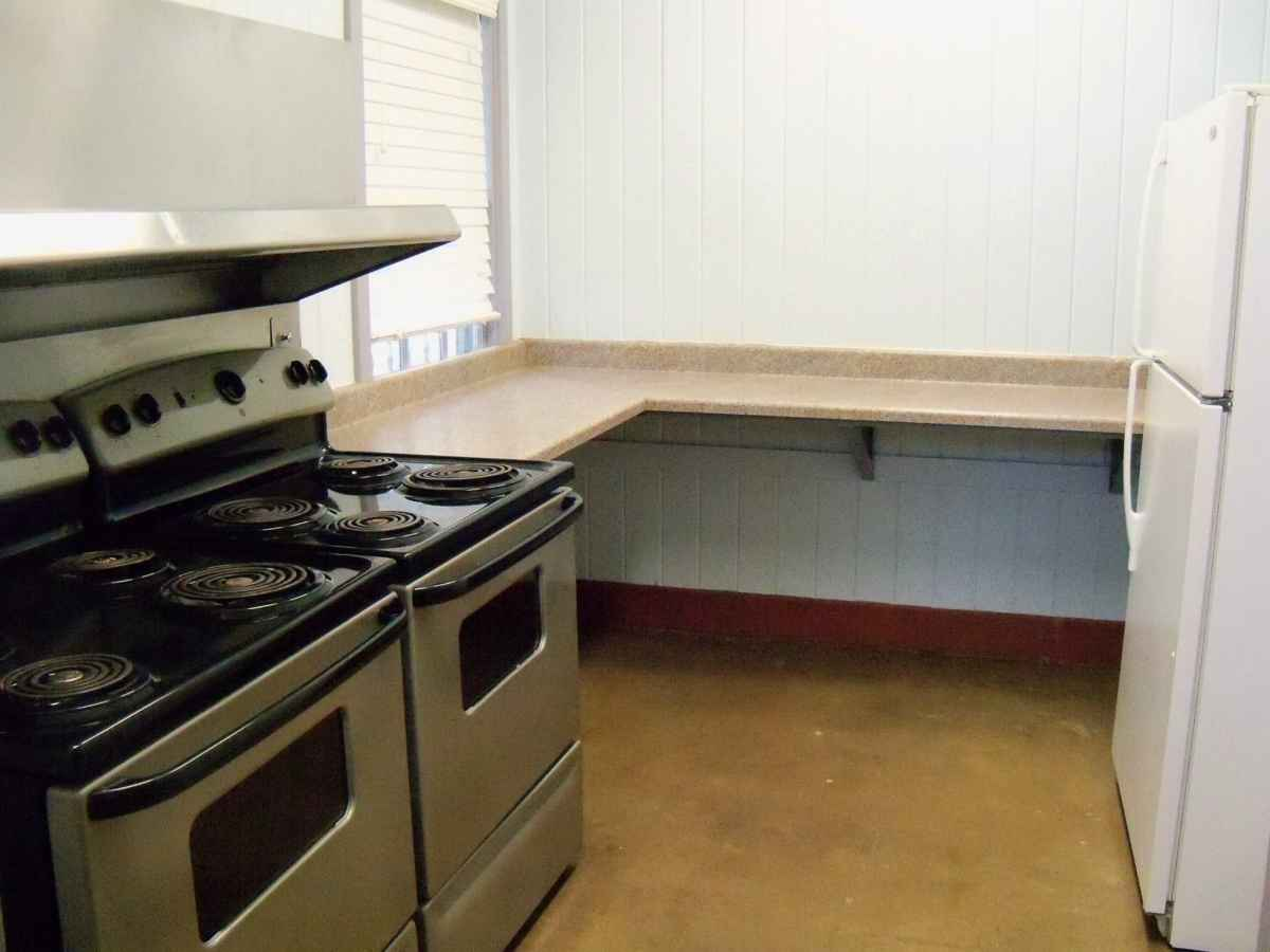 There are two 4-burner stoves with ovens and lots of shelf/prep space.