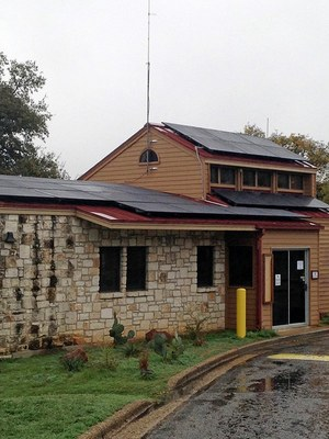 Enchanted Rock's headquarters building with solar panels on the roof.