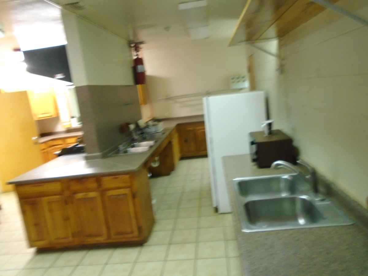 There are two double sinks in the kitchen.