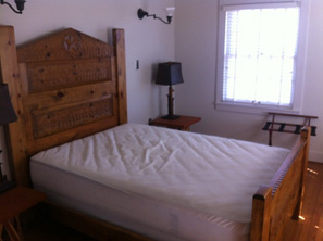 The master bedroom has a queen bed.