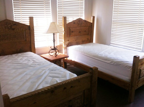 The second and third bedrooms each have 2 twin beds.