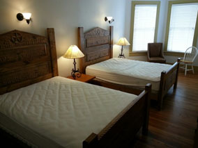 The second bedroom has 2 full beds.