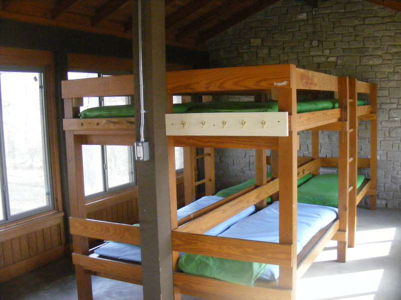 Inside one of the four Shelters with A/C, heating, and four sets of bunkbeds.