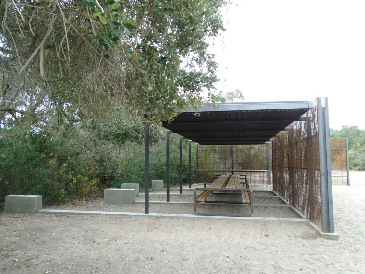 Group picnic table with shade shelter.