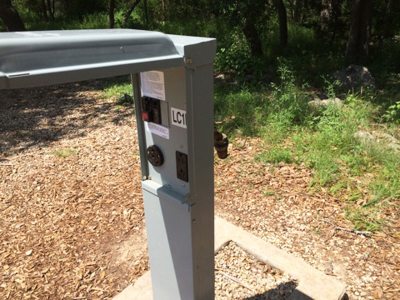 An electrical hook-up post in the Cedar Sage area. & Guadalupe River State Park Standard Campsites (Water and ...