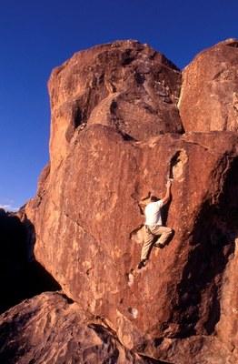 Rock climber on steep face.