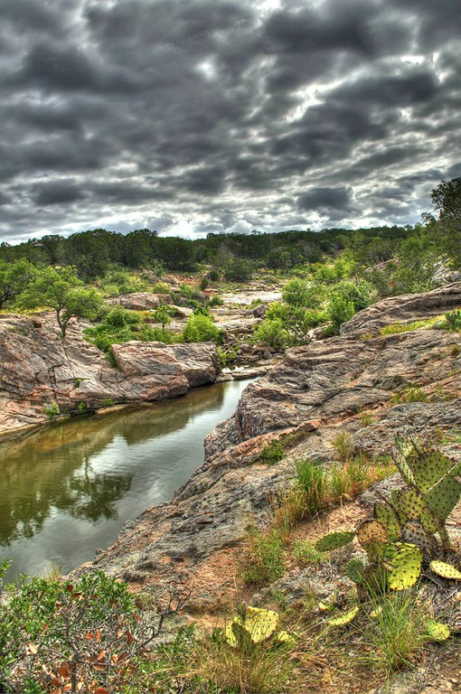 View of rock outcrops with water in between.