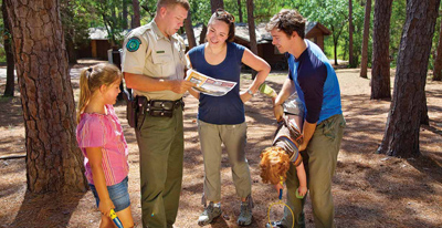 A Park Police Officer helping park visitors.