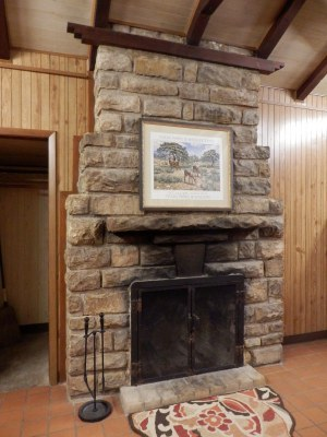 Fireplace made of local stone in one of the cabins