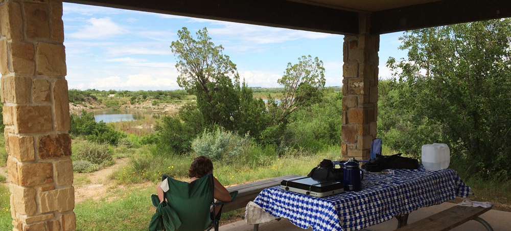 Sitting on the porch of one of the cabins.