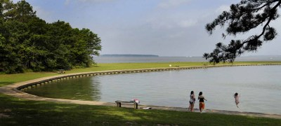 Wheelchair accessible cement route along the swimming area of the lake at Lake Livingston State Park.