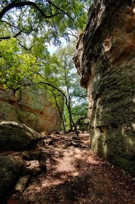 narrow area between two vertical sandstone walls