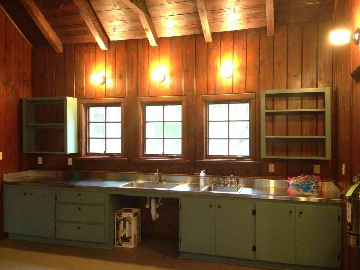 The kitchen has 2 sinks and lots of shelf space.