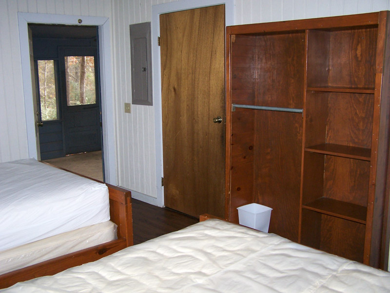 The Bedroom with a view out to the attached, screened-in back porch.