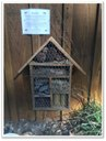 Insect house with compartments holding different natural materials