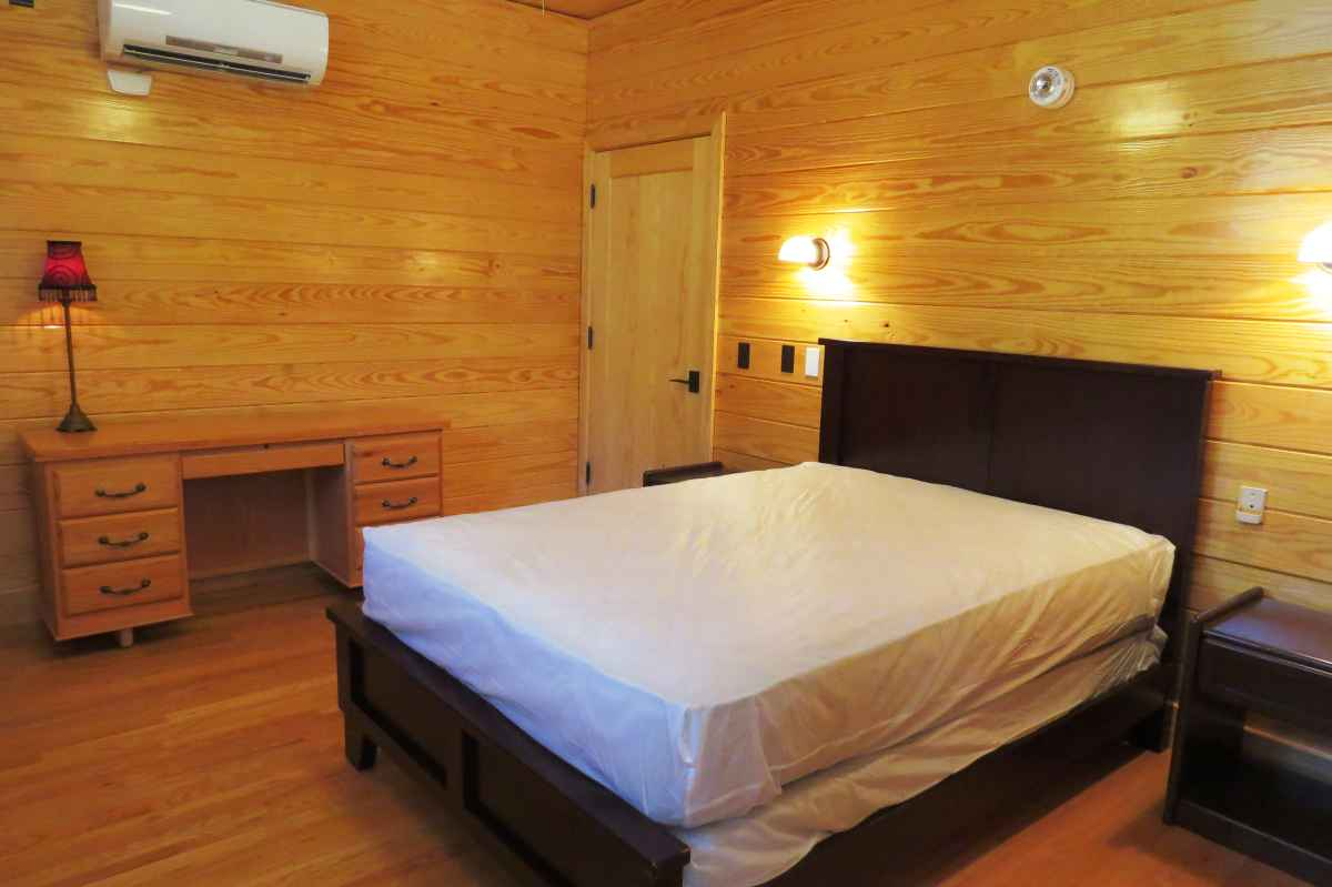 The cabin has four bedrooms; one is ADA accessible (designed to be usable by people in wheelchairs) with a full-sized bed.