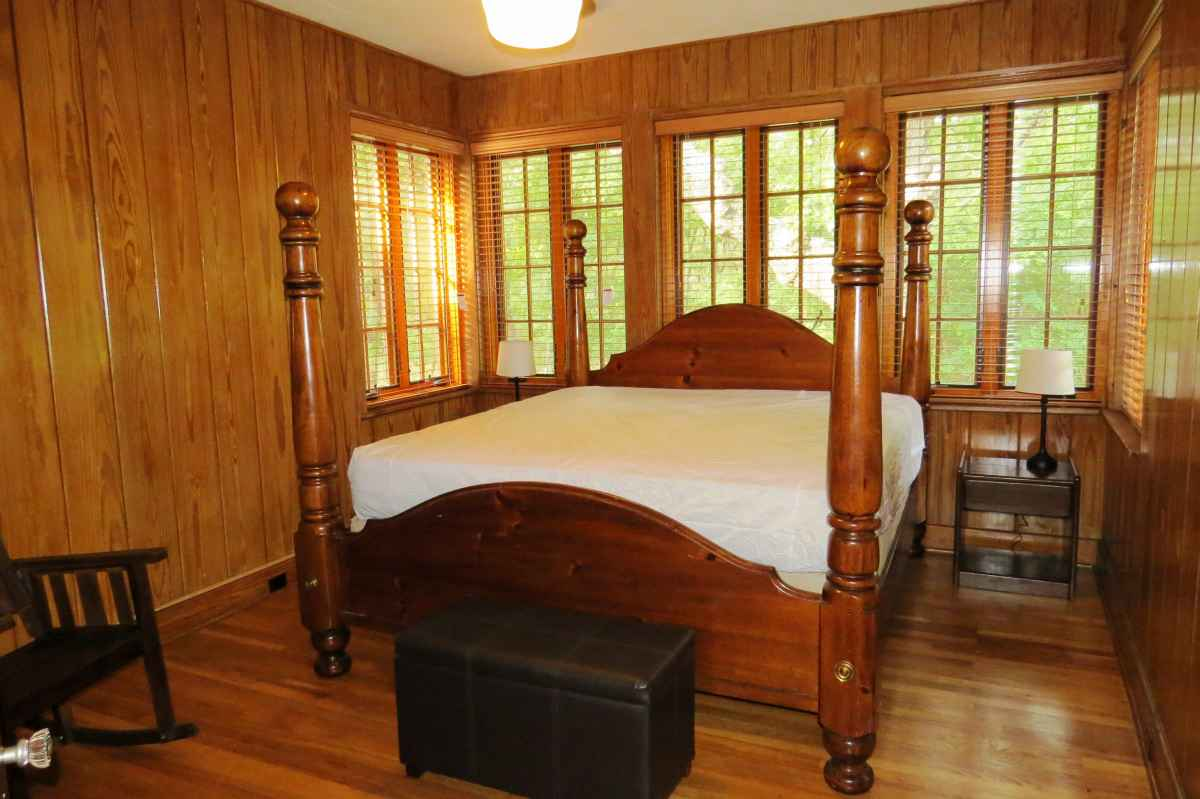 The cabin has four bedrooms; one has a king-sized bed.