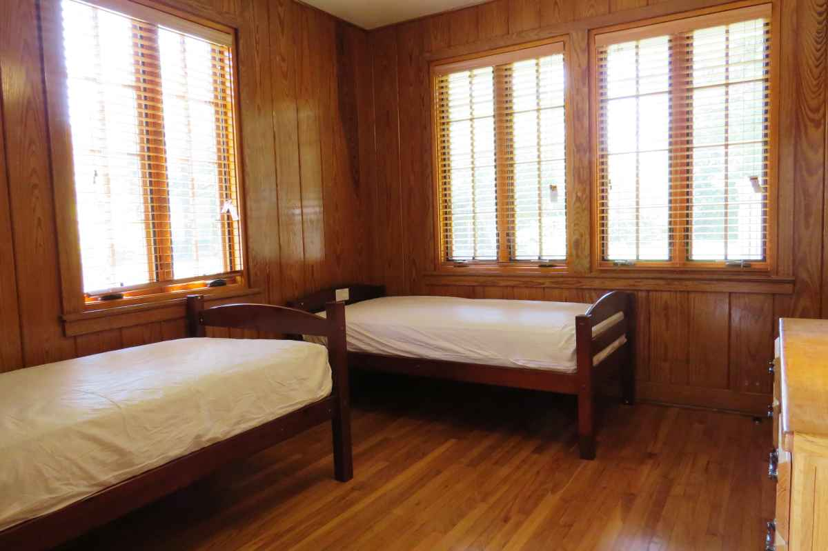 Another view of the bedroom with two twin beds.