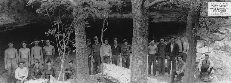 CCC workers standing in front of a cave.