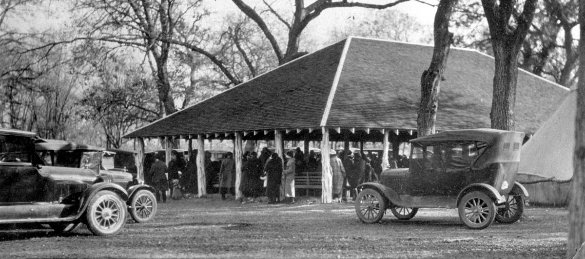 Historical photo of people gathered at a pavilion