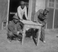 CCC workers working on table.