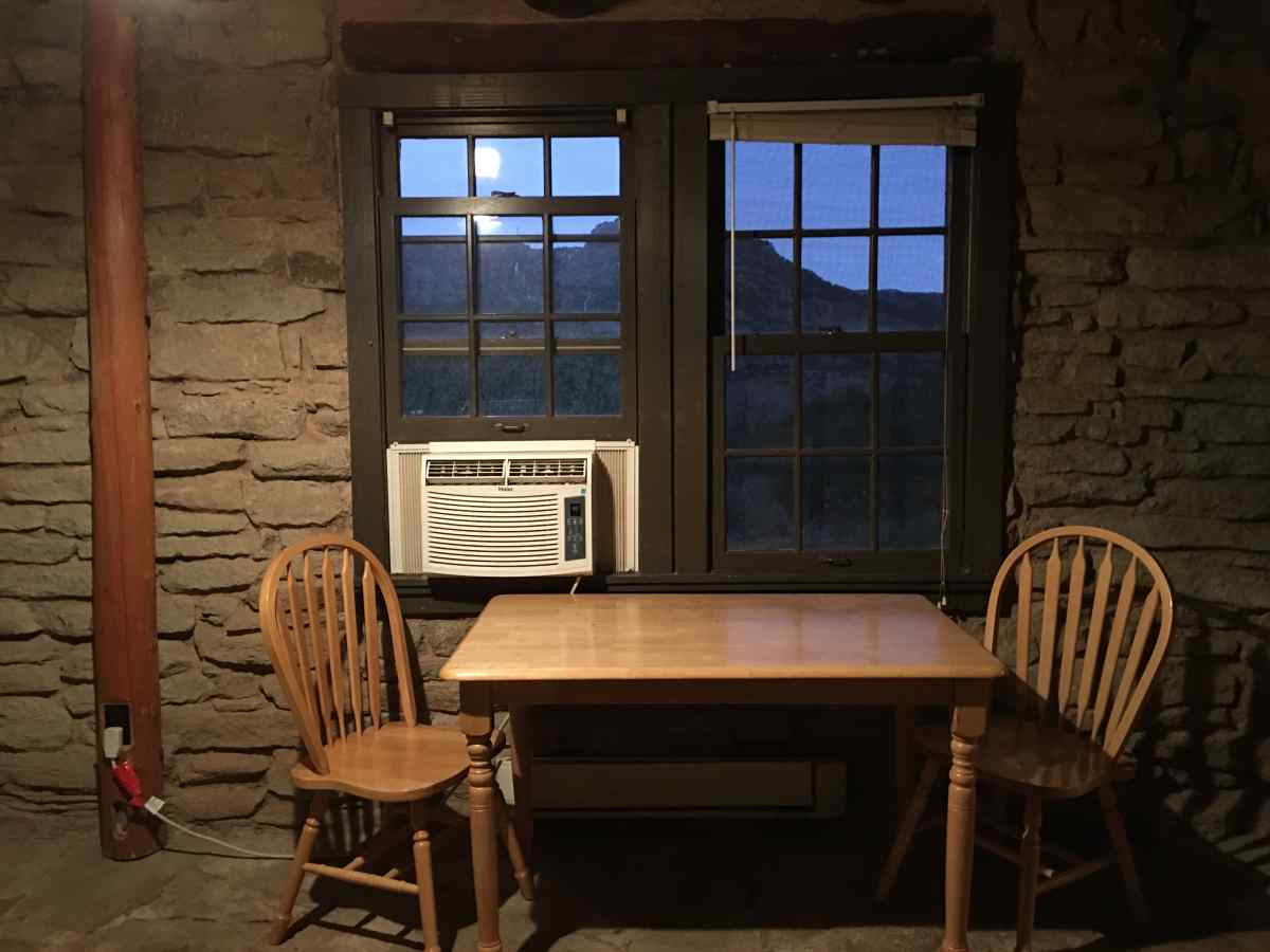 Inside Cow Camp Cabin #1. A view of the table and A/C unit.