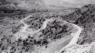 Winding road built by the CCC that goes down into the canyon .