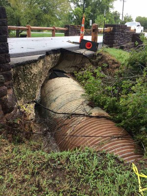 Damaged culvert, with part of road eroded