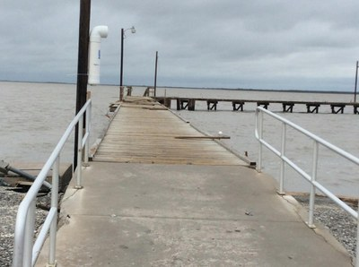 Pier with railings and some boards missing