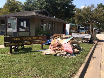 Flood damaged debris in front of park headquarters