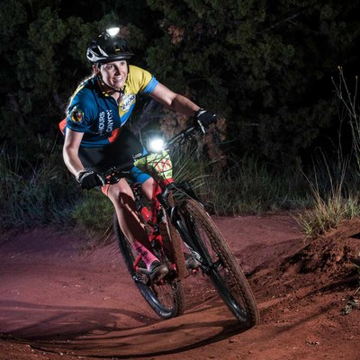 Woman riding mountain bike in racing clothes