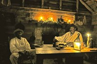Two reenactors in a slave cabin at Barrington Farm