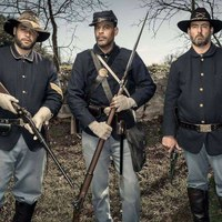 Three costumed Buffalo Soldier reenactors