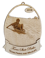 ornament shows person riding a sand disk