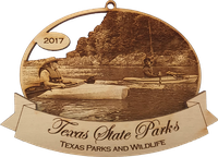 ornament shows person in canoe on the creek