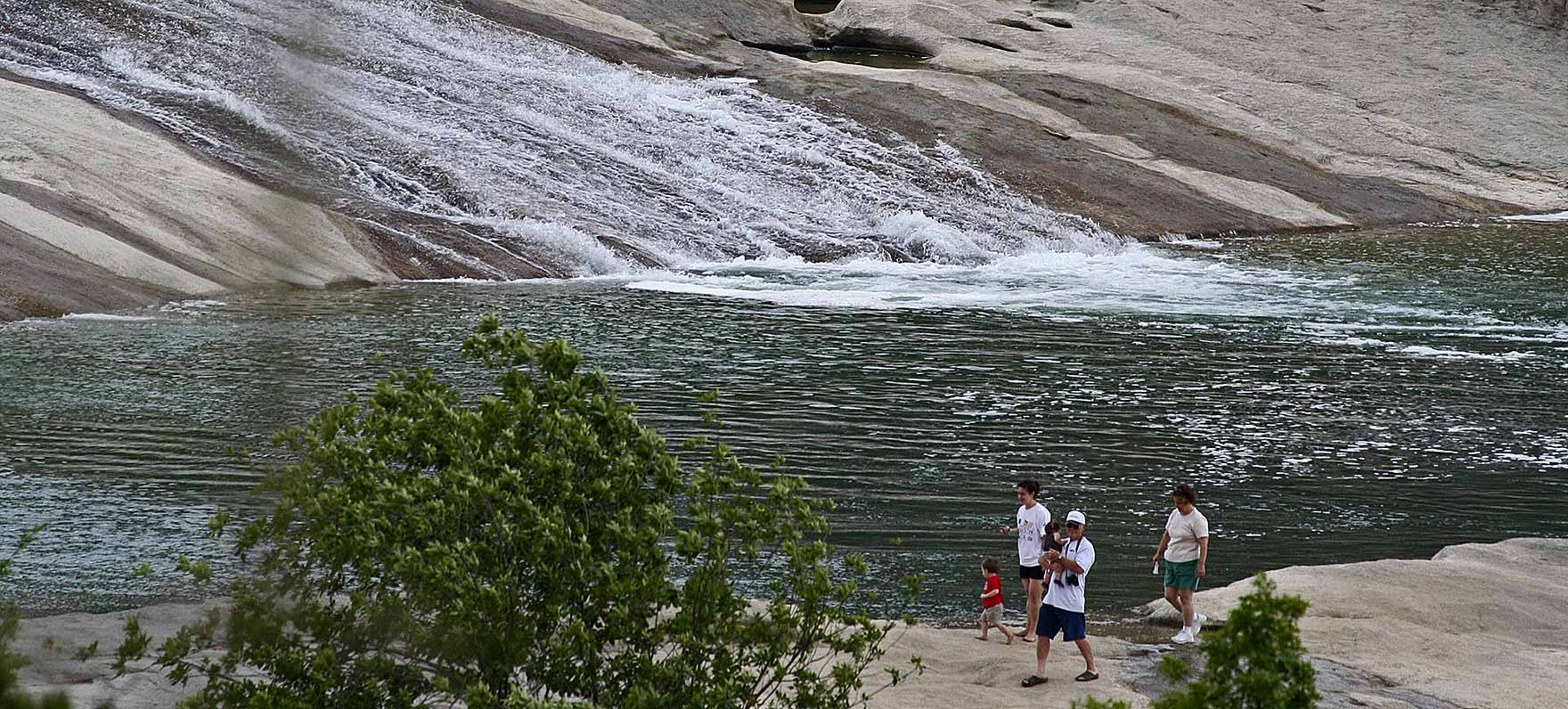 Pedernales Falls State Park. Follow The Pedernales River As It Cascades  Over Steps Of Layered Limestone To Create The Picturesque