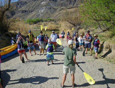 A photo of a Texas Outdoor Family workshop kayak lesson at Big Bend Ranch State Park.