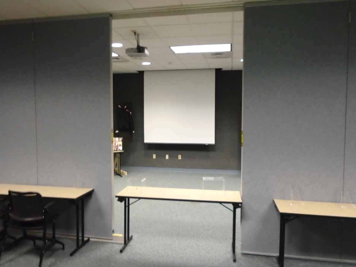 There is a projector and a projection screen inside the Meeting Room.