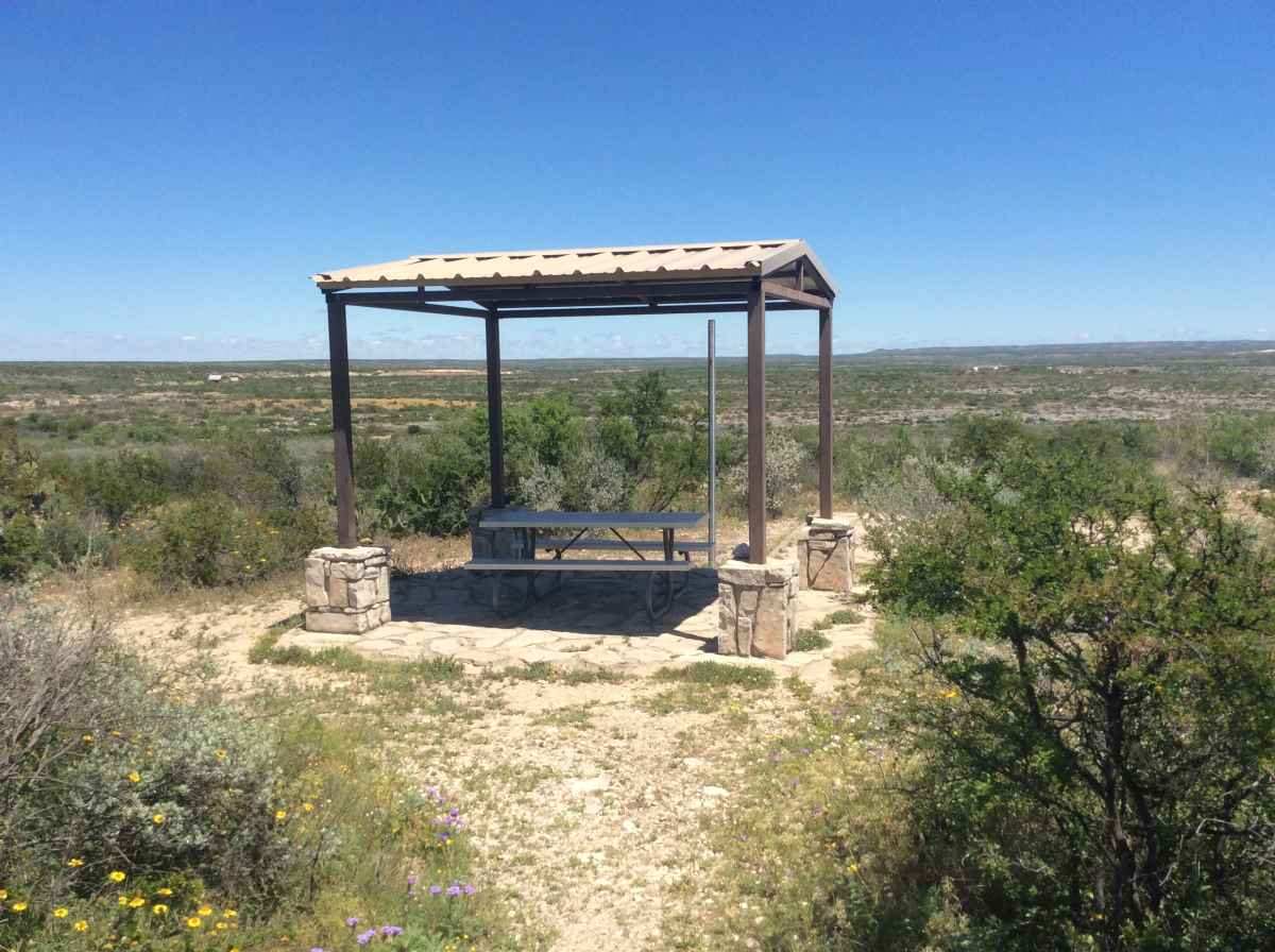 The picnic table and shade shelter at Campsite 9.