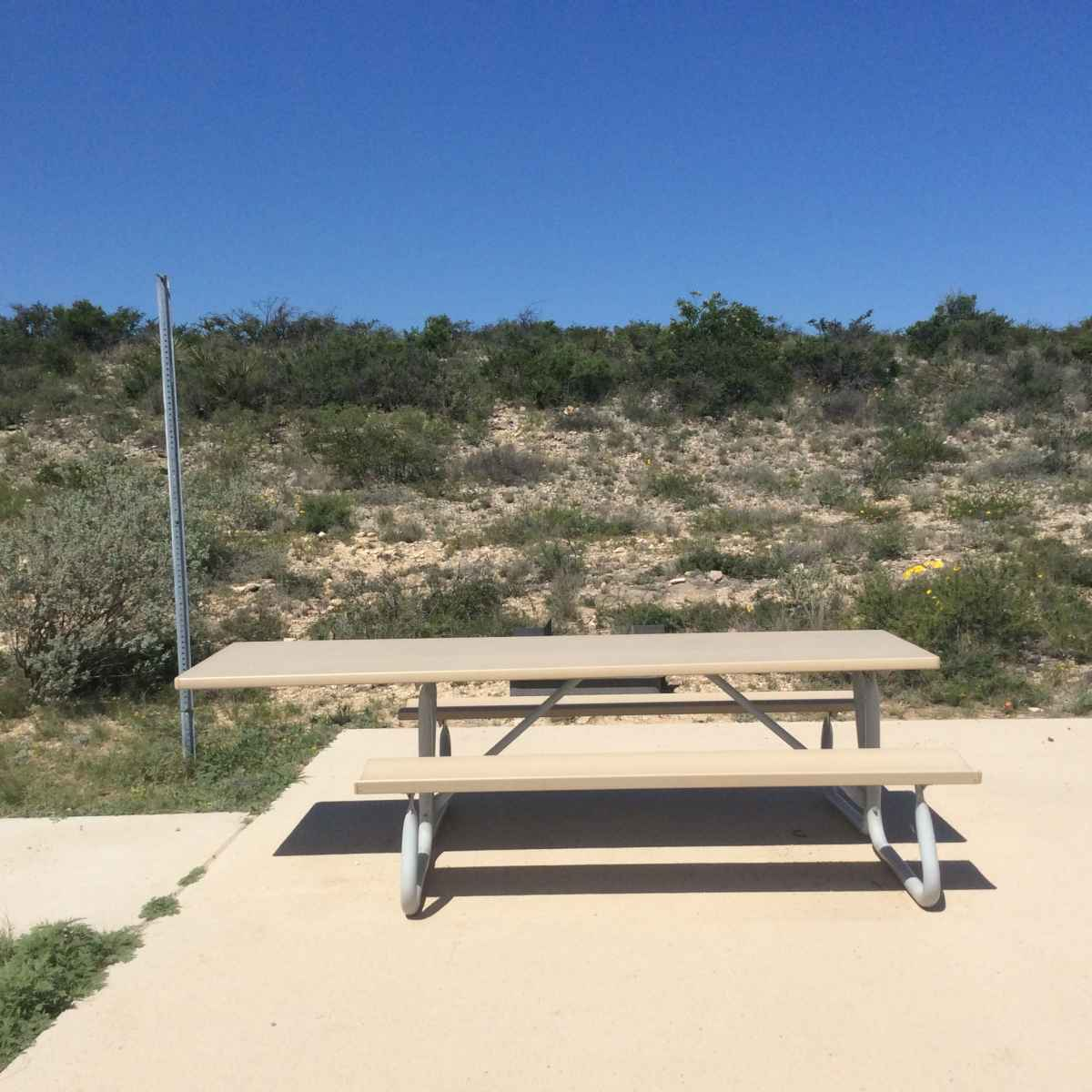 The picnic table at Campsite 35 is wheelchair friendly.