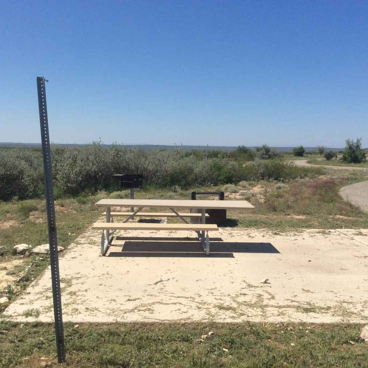The picnic table and fire ring at Campsite 43 is designed to be usable in a wheelchair.