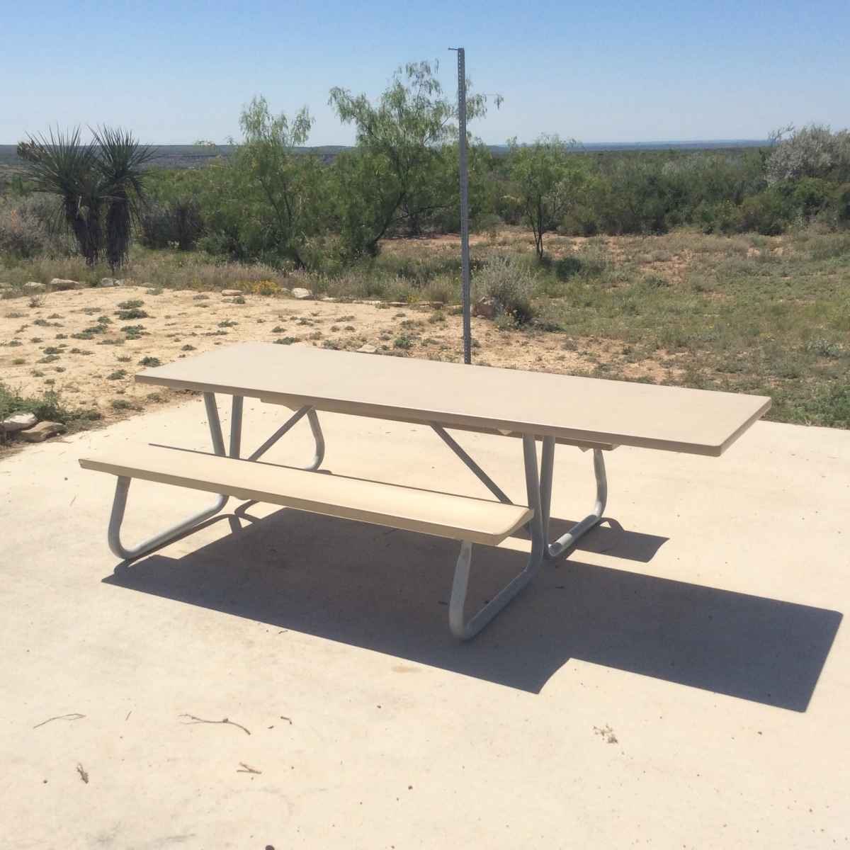 The picnic table at Campsite 44 is designed to be usable by people in wheelchairs.