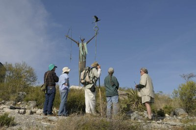 Hikers gather around the Maker of Peace sculpture