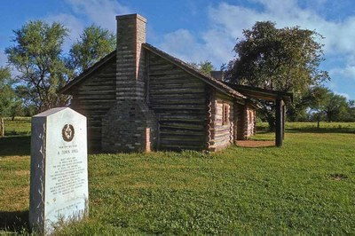 historic log cabin and marker at San Felipe de Austin
