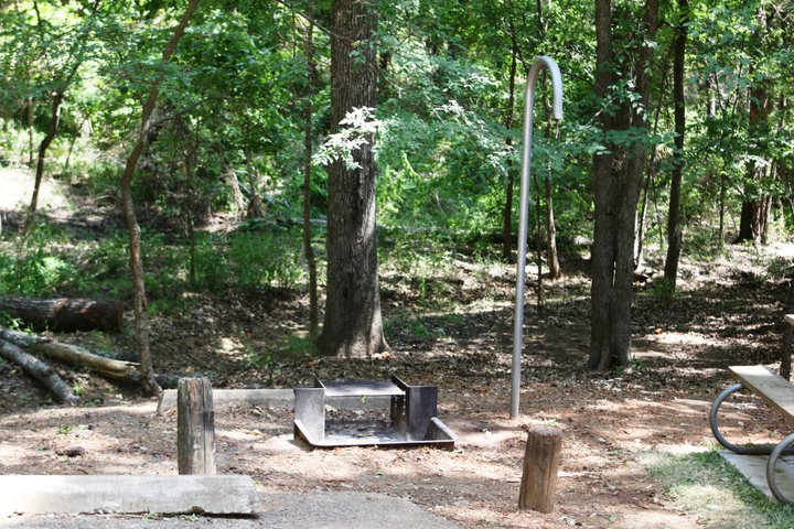 All cabins have a fire ring / grill, lantern hook, and picnic table, outside.